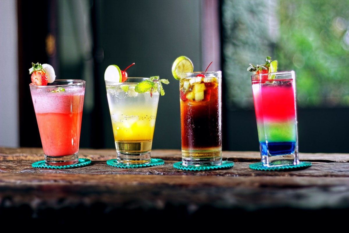 alcoholic beverages lined up on a bar