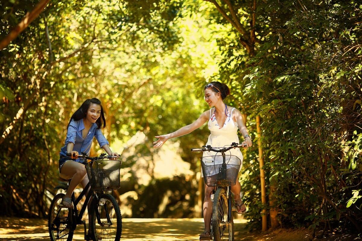 two women riding bikes