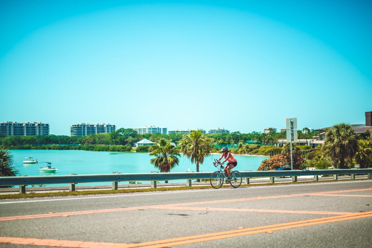 woman riding her bike on the Lido Key bridge