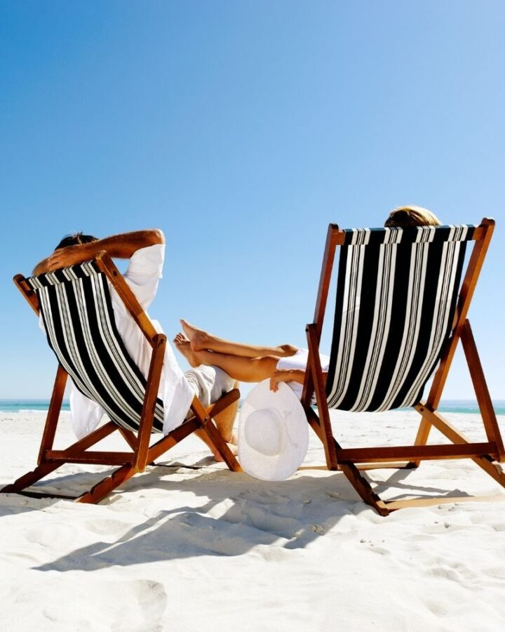 couple on chairs at beach