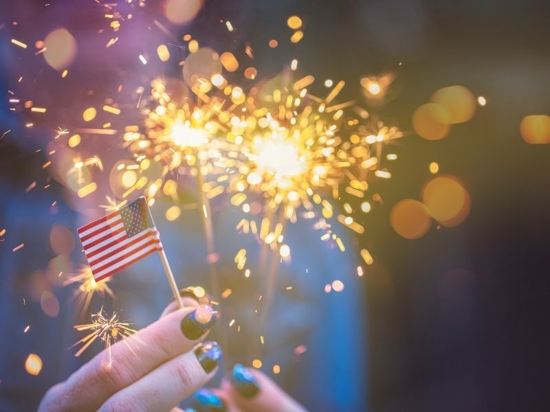 upclose of sparkler and tiny american flag