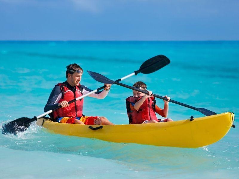 man and boy kayaking
