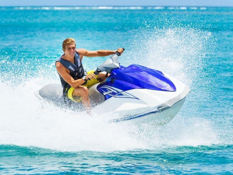 man on jet ski on water