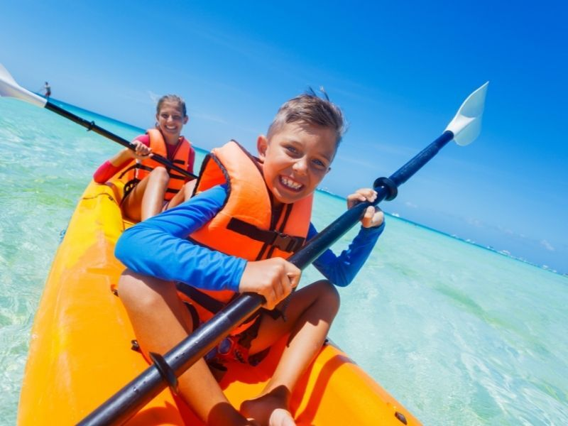 child and adult kayaking