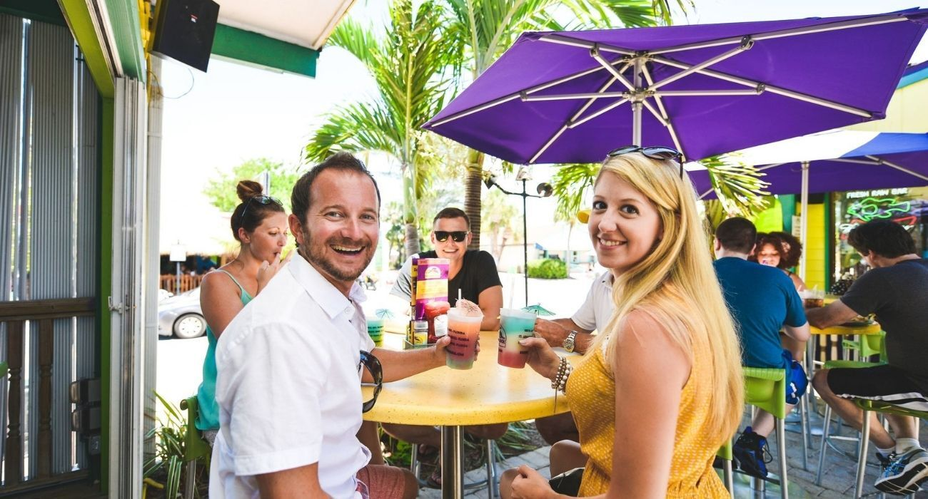 two couples enjoy the outdoor patio at Daiquiri Deck